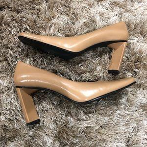 Nine West tan size 7.5 heel shoes.